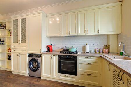 Photo pour modern cream colored kitchen interior - image libre de droit