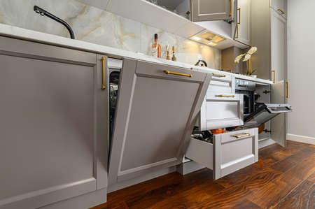 Photo pour Closeup details of grey and white modern classic kitchen, all doors are open - image libre de droit