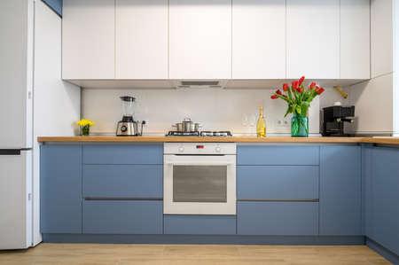Photo pour Modern blue-teal kitchen interior, furniture front view - image libre de droit