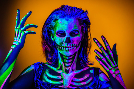 Skeleton bodyart with blacklight studio portrait
