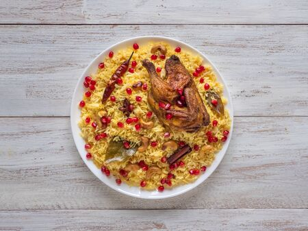 Photo pour Arabic Dishes, Eid Recipes. Yemenis style. Festive dish with baked chicken and rice. Top view, copy space.  - image libre de droit