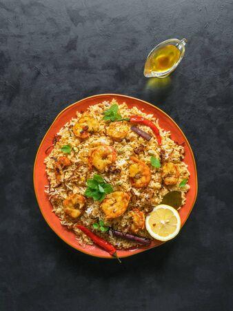 Photo pour Traditional Indian Biryani with shrimp. Tasty and delicious prawns biryani, top view. - image libre de droit