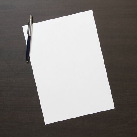Photo pour Template of white paper with pen on dark wenge color wooden background. Concept of business plan and strategy. Stock photo with empty space for text and design. - image libre de droit