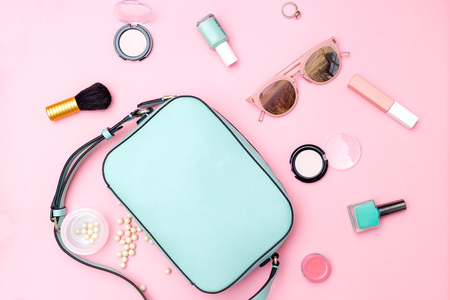Photo for Female accessories and make up pastel color on pink background. Flat lay - Royalty Free Image