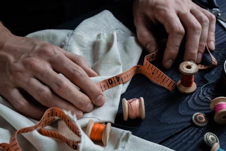Photo pour Male tailoring, sewing close up hands, craftsman - image libre de droit