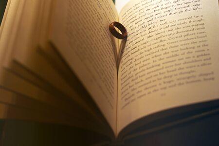 Foto de The ring in the book. Wooden ring. Abstract photo - Imagen libre de derechos