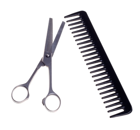 Hairdressing scissors and comb  isolated on a white background.