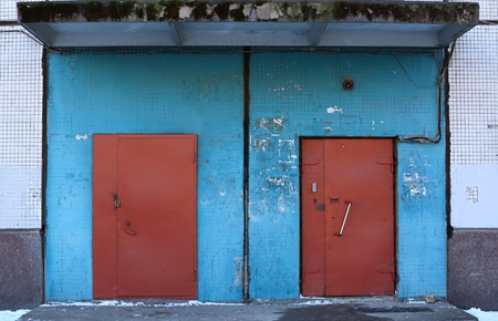 Photo for Metal brown doors in blue wall - Royalty Free Image