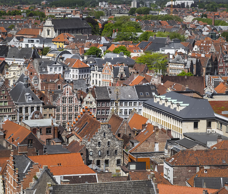 Ghent, Belgium - The historic center of the city, the motley tiled roofs and facades of old houses on a sunny spring morning