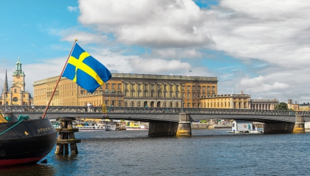Swedish flag with the Royal Castle in background, Stockholm