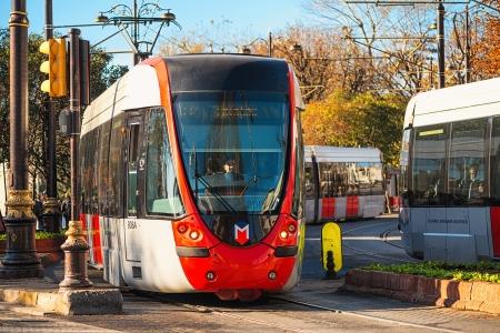 ISTANBUL - NOV, 23  Public transport in Istanbul, modern tram trains meeting in Sultanahmet district on cobbleroad, Nov 23, in Istanbul, Turkey 2013