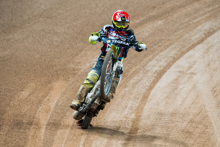 STOCKHOLM - SEPT 26, 2015: Chris Holder from the USA celebrates the heat victory with a wheelie on the TEGERA Stockholm FIM Speedway Grand Prix at Friends Arena in Stockholm.
