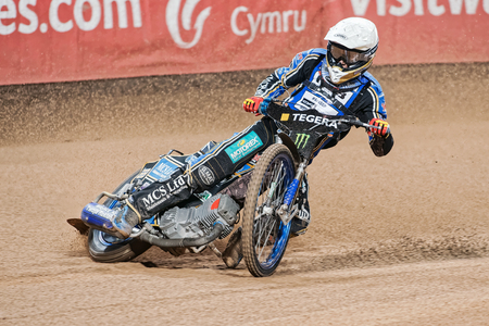 STOCKHOLM - SEPT 25, 2015: Speedway rider in curve at the TEGERA Stockholm practice for the FIM Speedway Grand Prix at Friends Arena in Stockholm.