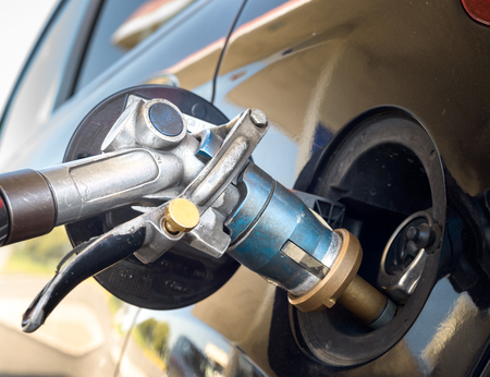 Photo for Fuel gun during liquid gas propane refill - Royalty Free Image