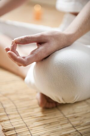 Photo for Hands of young woman meditating, focus on the hand - Royalty Free Image