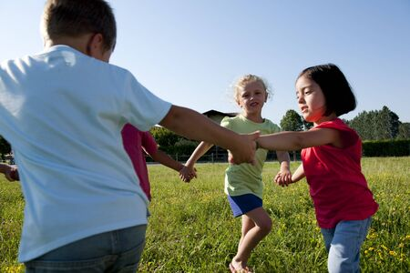 Small group of children playing ring-around-the-rosy