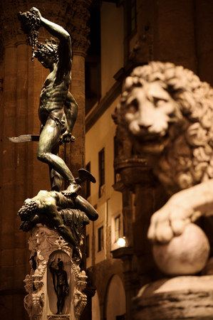 Perseus Statue and the Medici Lion - Loggia del Lanzi, Piazza de la Signora, Florence, Tuscany, Italy, Europe Protected by the Giant Lion, Perseus proudly hold the Head of Medusa