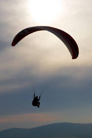 paraglider in back light