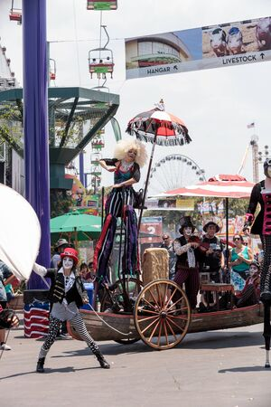 Costa Mesa, CA, USA - July 14, 2017: Theatrical circus performer Megan Fontaine, part Mango and Dango, performs with Dragon Knights steampunk stilt walkers at the Orange County Fair in Costa Mesa, CA on July 16, 2016. Editorial use only.