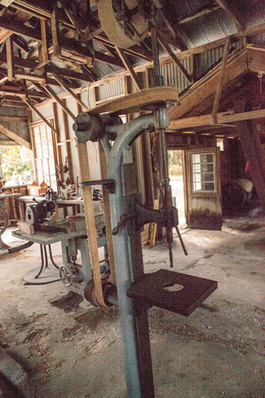 Estero, Florida, USA - February 23, 2019:  Antique H.G. Barr Drill Press inside the 1904 Large Machine Shop at historic Koreshan State Park.