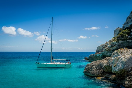 Recreational sail boat in Mediterranean sea coast. Mallorca island, Spain