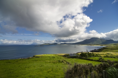 beautiful landscape with the green fields and the sea in Connemara, Ireland