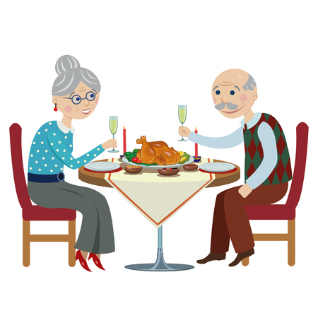 Happy elderly people at Christmas table.