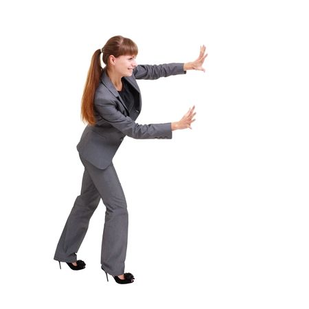 Business woman pushing something, isolated on a white background with copyspace