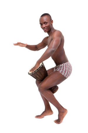 Happy man drumming on  tomtom on a white background