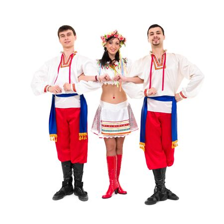three dancers wearing a folk ukrainian costumes posing against isolated white background