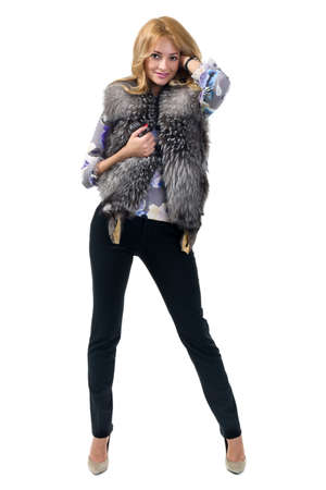 Woman trying jacket with fur. Beautiful young woman caucasian ethnicity, isolated on white background in full length.