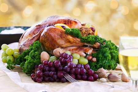 Photo for Roasted turkey on holiday table ready to eat. Selective focus on turkey. - Royalty Free Image