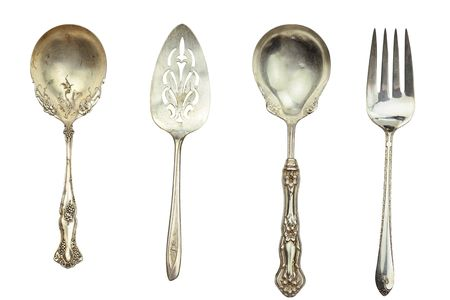 Antique silverware isolated on white.