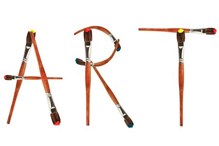 Photo pour Isolated paintbrushes form the word art against a white background. - image libre de droit