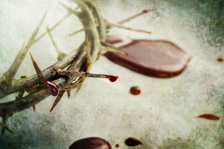 Crown of thorns with drops of blood over grunged background