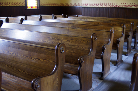 Photo for Carved Wooden pews in church - Royalty Free Image