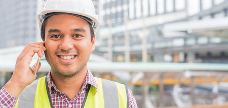 Photo pour Young asian civil engineering talking on phone at construction building background. - image libre de droit