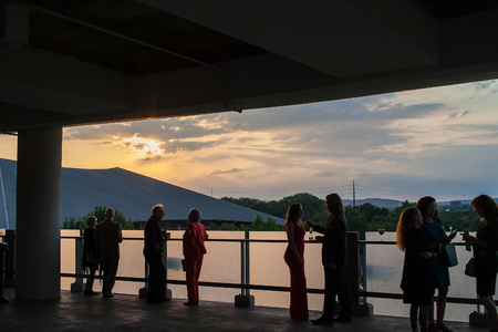 May 2017, Austin, Texas: A group of people stand on the balcony at the Long Center in Austin before the symphony