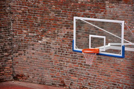 Basketball hoop and an empty outdoor court.