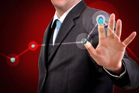 Businessman pressing a touchscreen button, copyspace