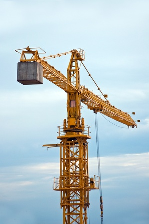 Photo for Yellow construction crane on a cold, cloudy day. - Royalty Free Image