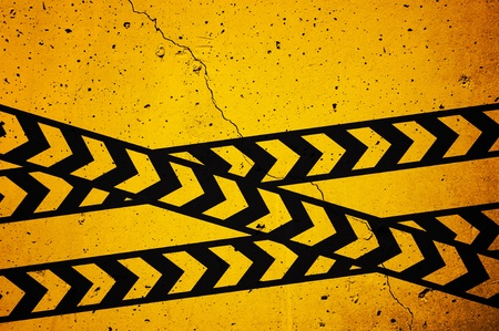Black and yellow  under construction  sign over a grunge texture