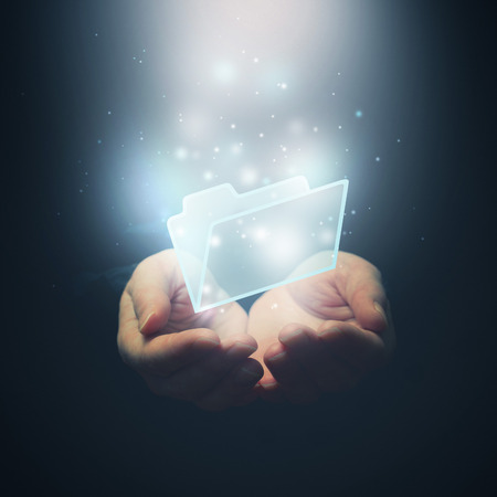 Open hands with file document file folder. File download concept. Selective focus.