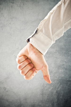 Businessman showing thumb down, disapproval symbol, conceptual image