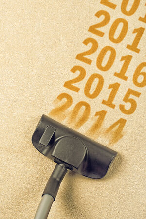 Vacuum Cleaner sweeping year number 2014 from Brand New Carpet leaving sequence 2015, 2016    Happy New 2015 year concept, leaving 2014 behind for a review
