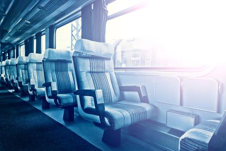 Interior of european economy class passenger train with empty seats.