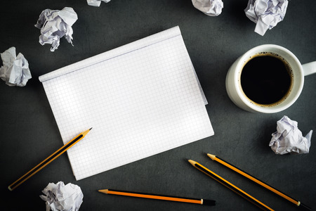 Creative Writing Concept With Pencils, Coffee Cup, Notepad and Crumpled Paper on Table, Top View.