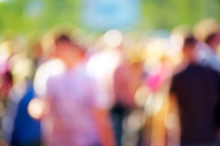 Blur crowd of people at public outdoors place or gathering, social event background, vivid colors, defocus image.