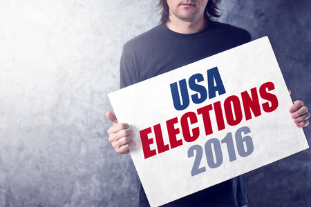 USA elections 2016, man holding poster for presidential rally
