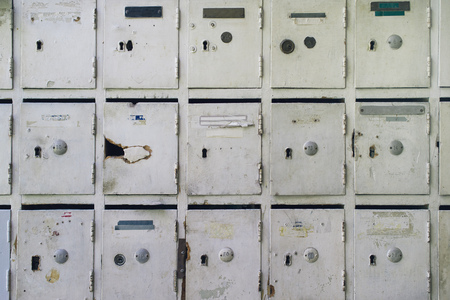Old mailboxes for post and letters inside of an aged ...